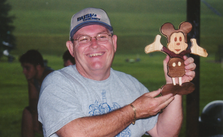 Steve shows off Mickey Mouse.tif