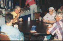 Lisa, TJ, TC, & Ed play cards.tif