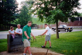 Trey & Kelly plays horseshoes.tif