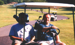 Steve Caudill and Roger on golf course.t