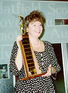Sheryle w golf trophy.tif