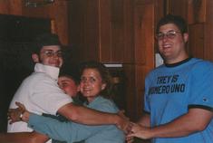 Joy & Boys in group hug.tif