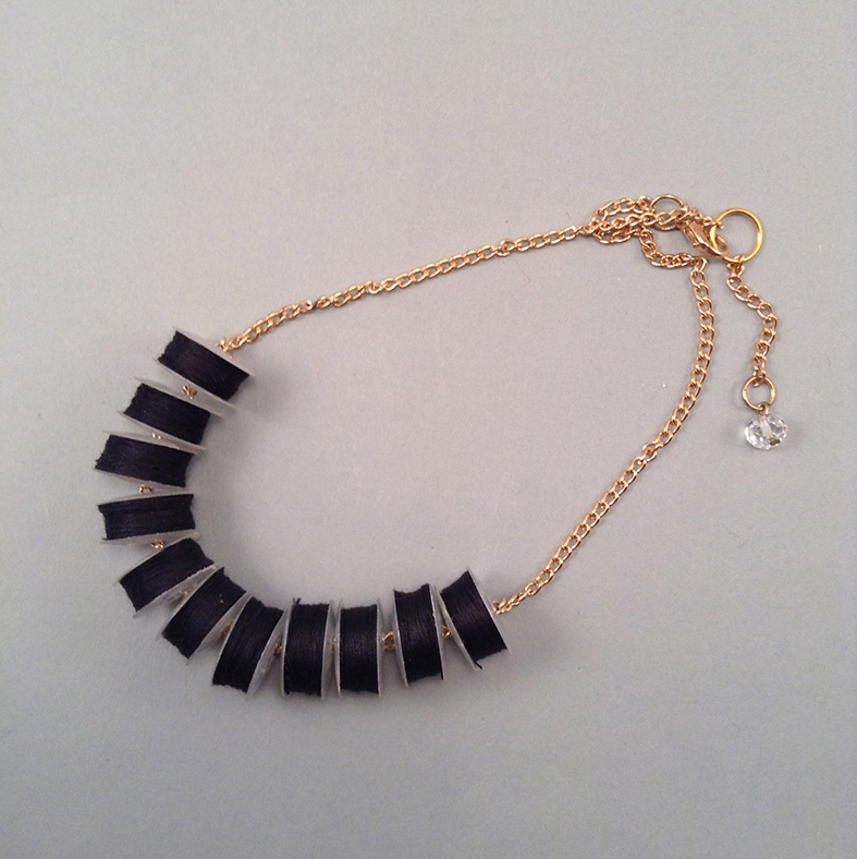 Black reel necklace