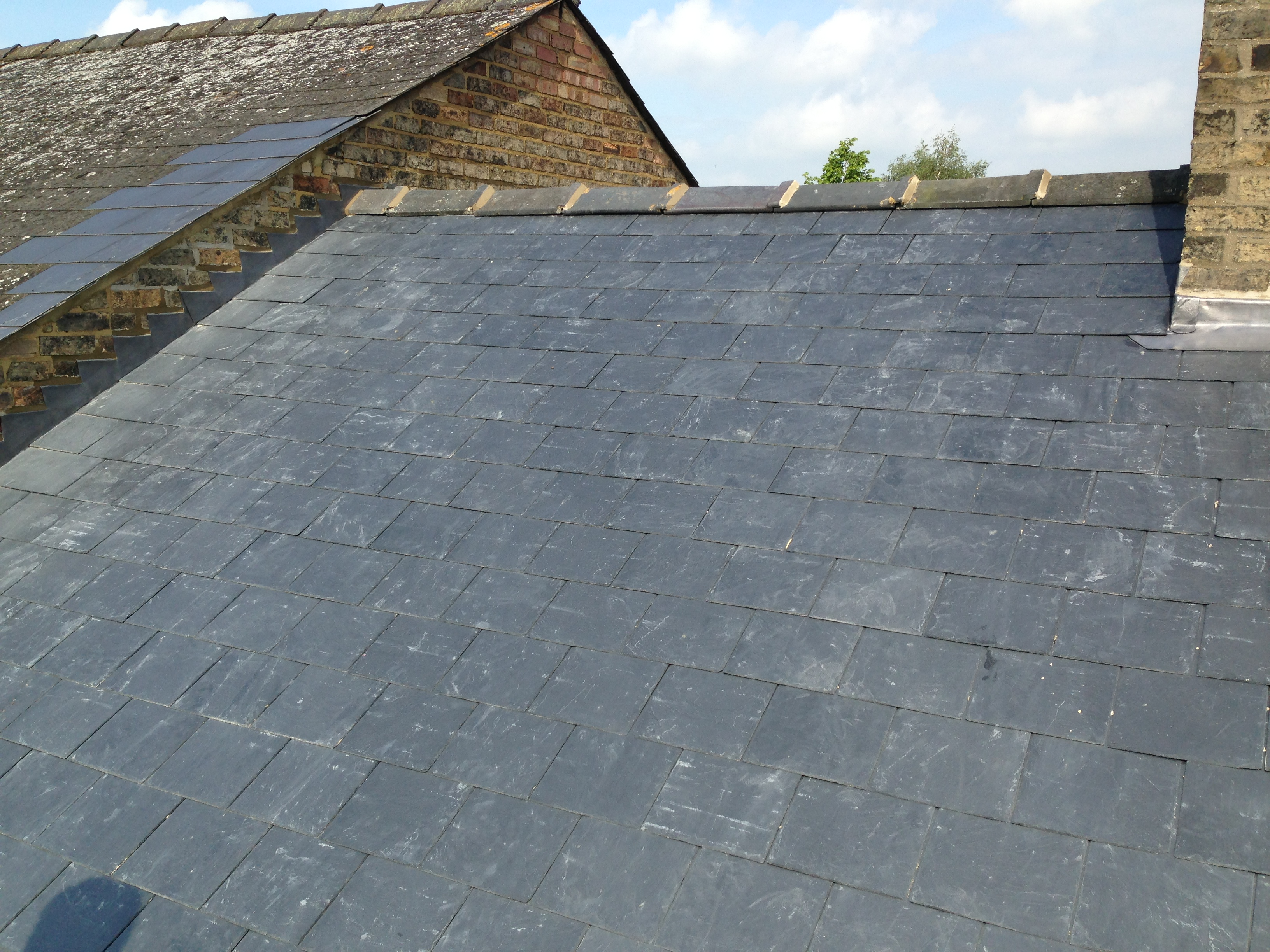Re-roof with natural Spanish slates