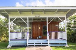 A large sauna is set up under a pavilion, with deck