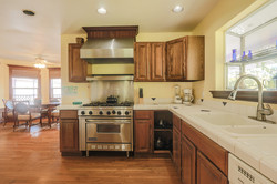 Kitchen features a Wolf range and a huge walk-in pantry