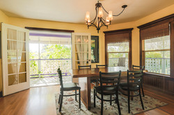Formal dining room, right off the kitchen, with large windows and French doors