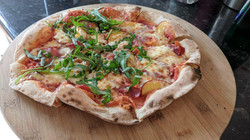 Apricot and proschuitto pizza