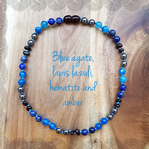 Boy's knotted necklace with hematite, lapis lazuli, blue agate and amber