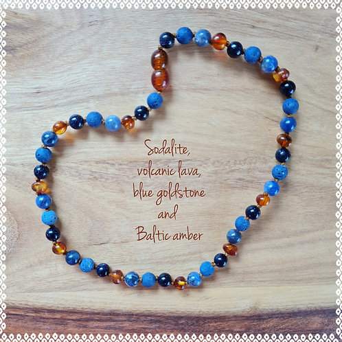 Necklace with sodalite, blue goldstone, volcanic lava and amber