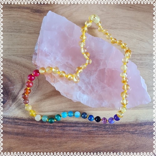Baby necklace with Baltic amber and a gemstone rainbow