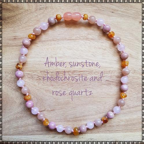 Necklace with amber, sunstone, rhodochrosite and rose quartz