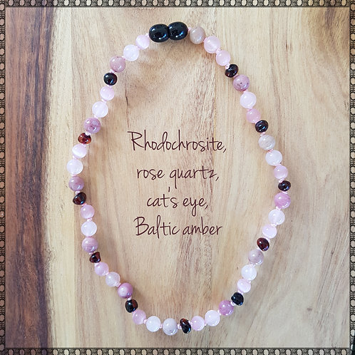 Necklace with rhodochrosite, cat's eye, rose quartz and Baltic amber