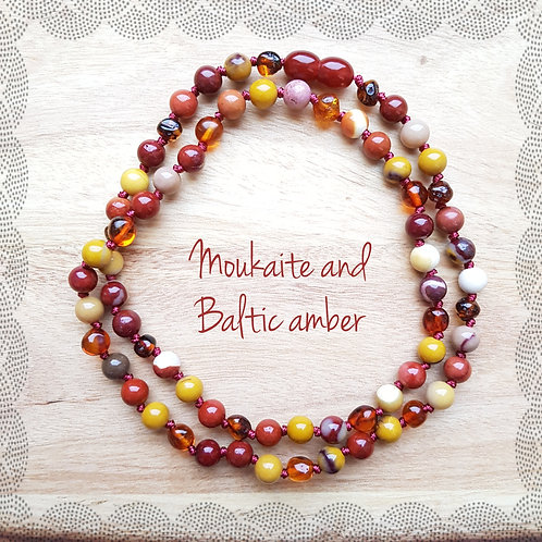 Knotted necklace with cognac amber and moukaite