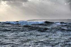 Big breaking seas over the Rock