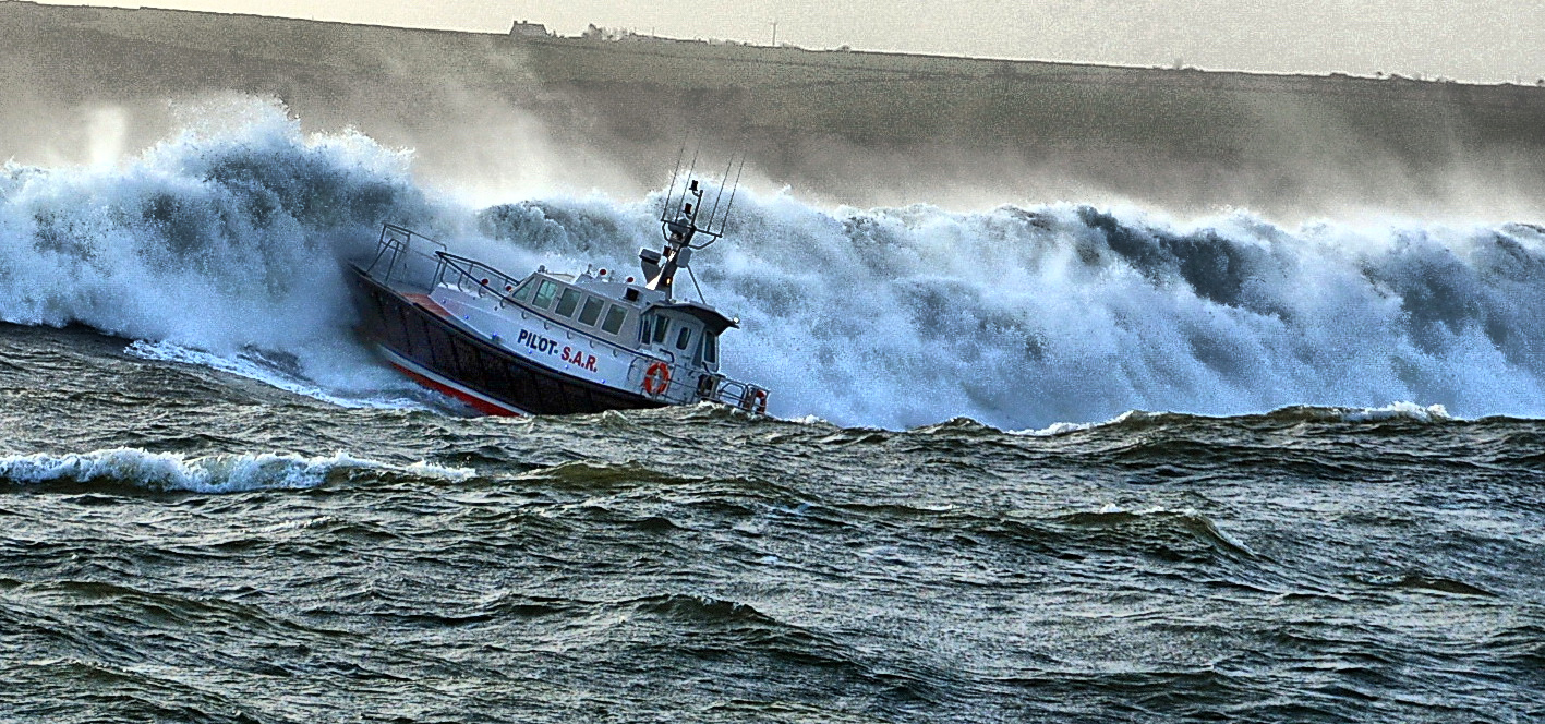 Pilot boat taking a big breaker