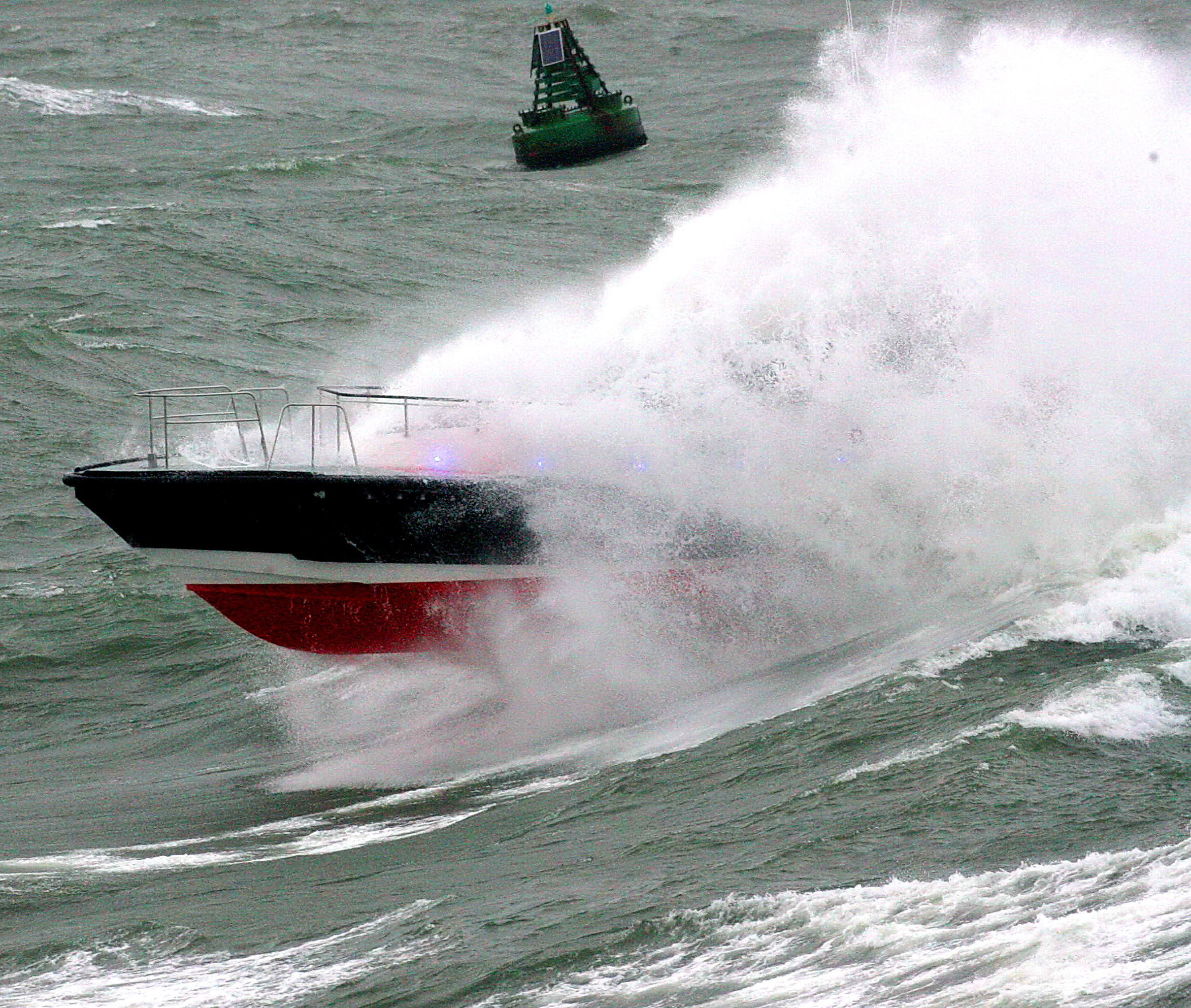 Pilot boat through wave 5
