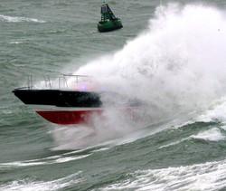 Pilot boat through wave 5