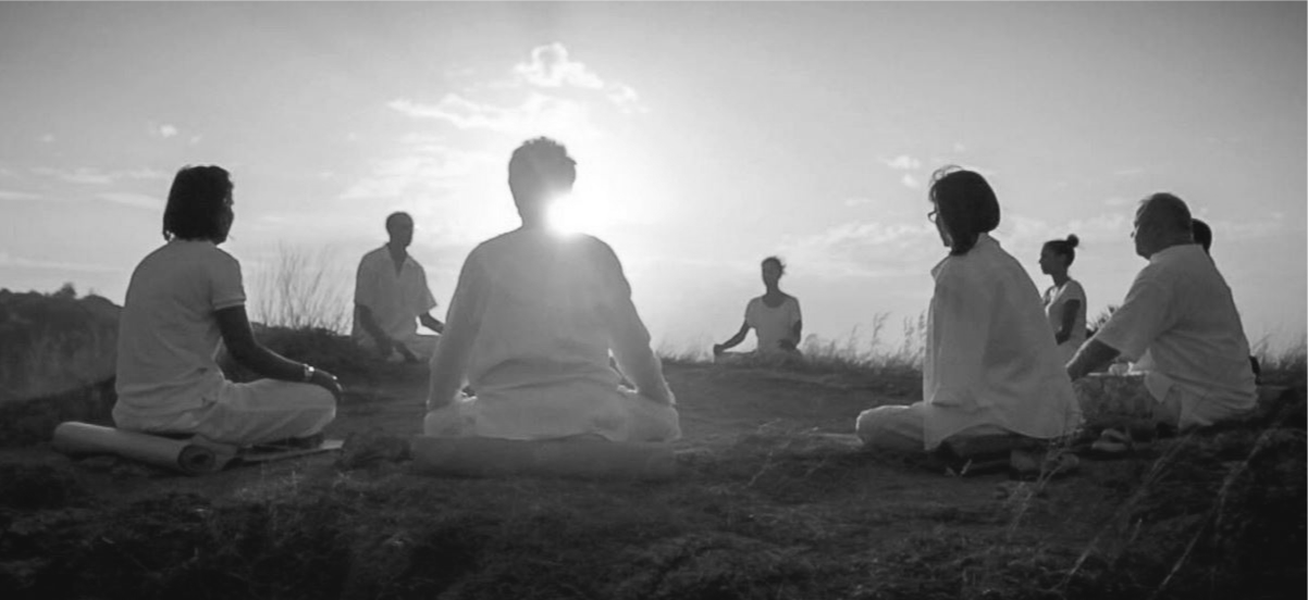 group meditating black and white.png