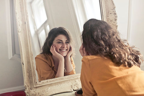 photo-of-woman-looking-at-the-mirror-774