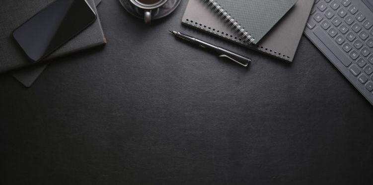 top-view-dark-stylish-workplace-with-sma