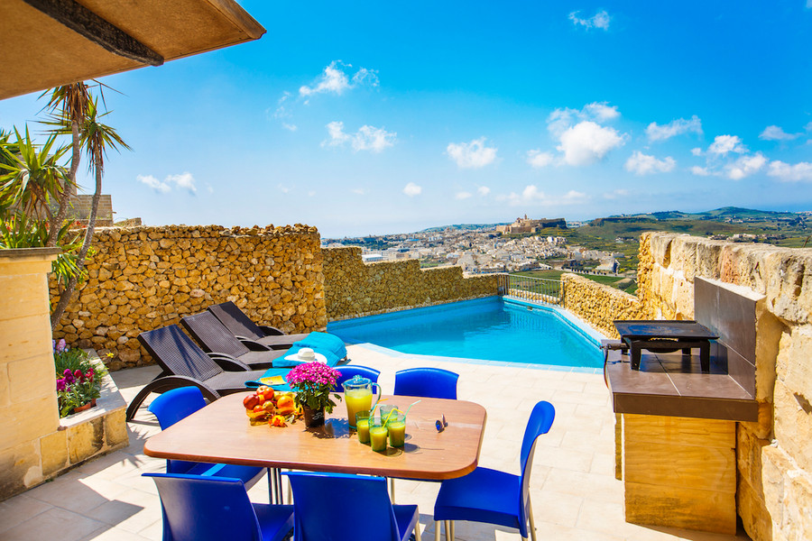 Outdoor area with pool and bbq
