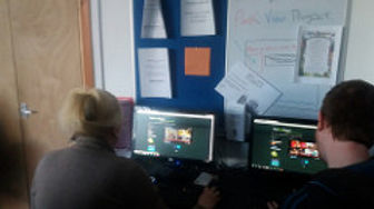 Volunteer helping out at our IT drop in session