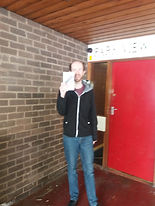 Robbie receiving his new mini tablet form Park View Project