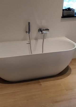 Klusjes plaatsen van bad