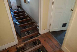 Inside house with pulled up floorboards