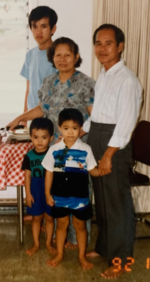 Me (center), my grandparents, younger cousin, and uncle