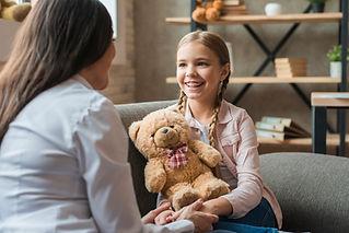 female-psychologist-talking-with-girl-ho