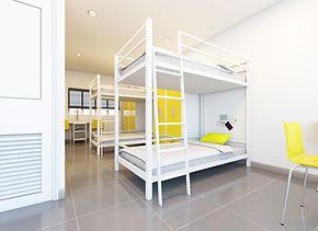 hostel-dormitory-beds-arranged-room.jpg