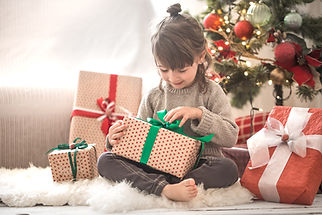 pretty-little-girl-is-holding-gift-box-s
