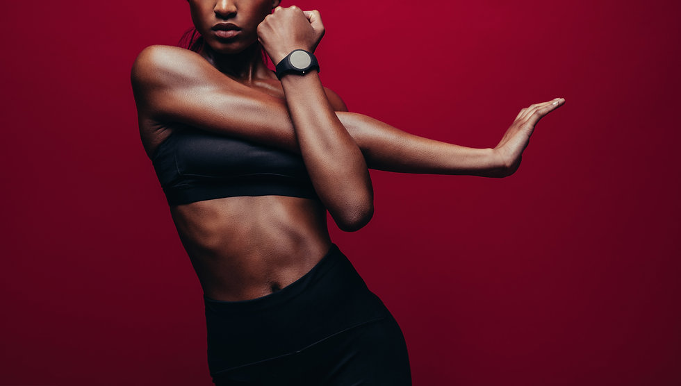 Cropped shot of woman stretching her arm
