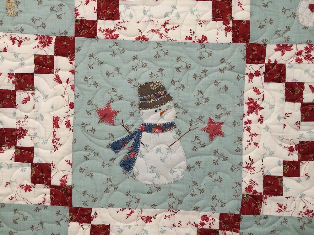 closeup of snowmen in bunny hill snowmen quilt