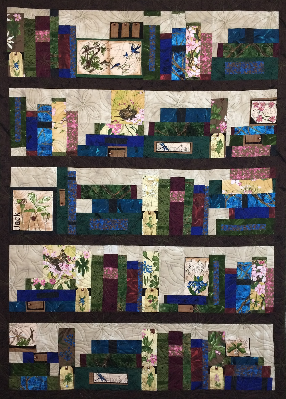 Beth Bookcase Quilt with a variety of books