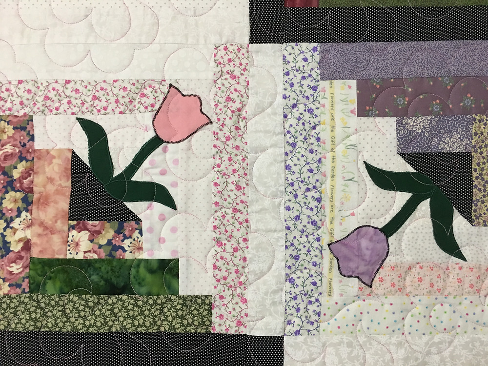 Curves Quilting Pattern on Log Cabin with Tulips Quilt by Dolores Steward
