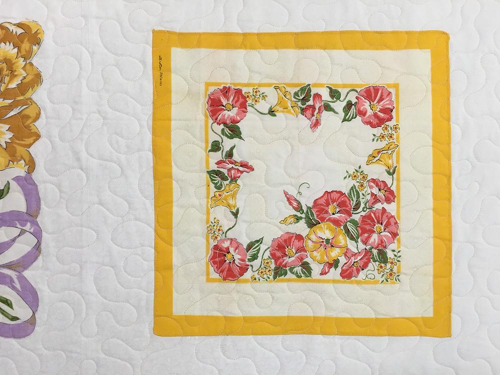 Meander quilting pattern on appliqued vintage hankie quilt by Susan Abram