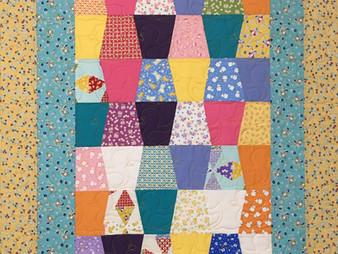 Cindy Lovelace Tumbler Block Baby Quilt
