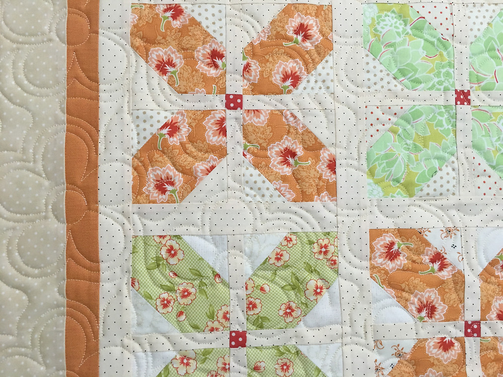 Flower quilting pattern on Petal Block Quilt by Deb Taylor