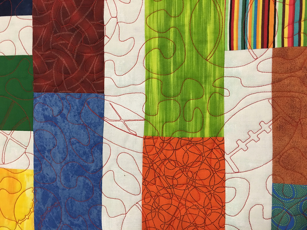 Sport Quilting Pattern on Bundle of 12 Quilt by Lynne Capps