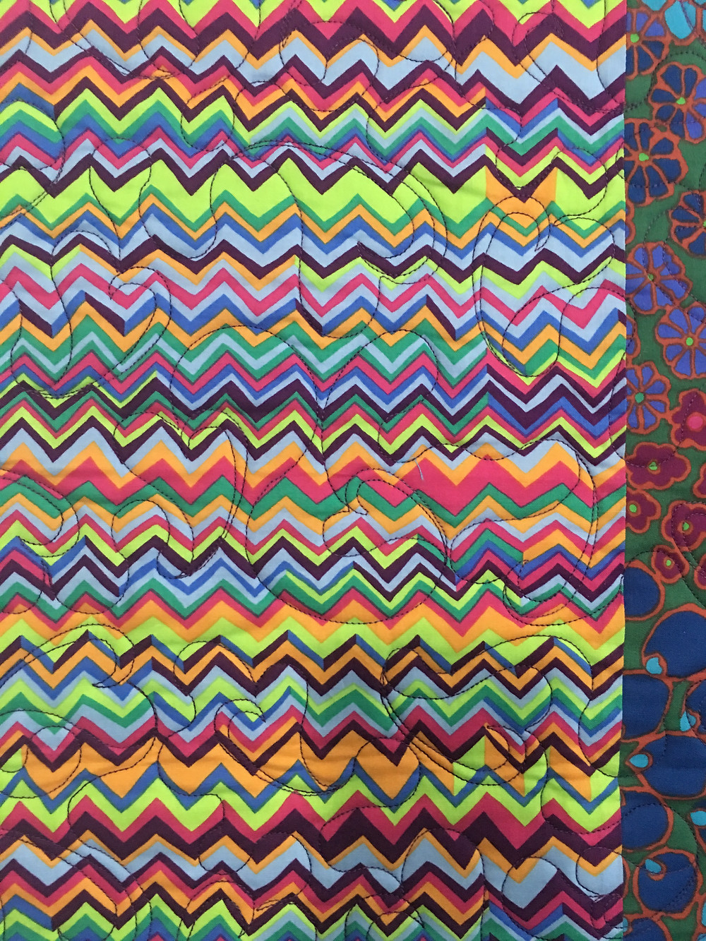 Close up of Delfina Daughter's Colorful Quilt
