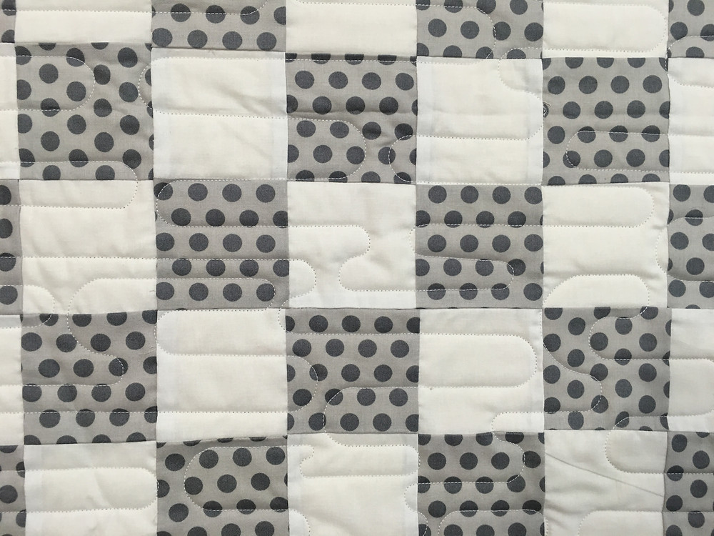Close up of quilting pattern on Lisa Long gray and white checkerboard quilt