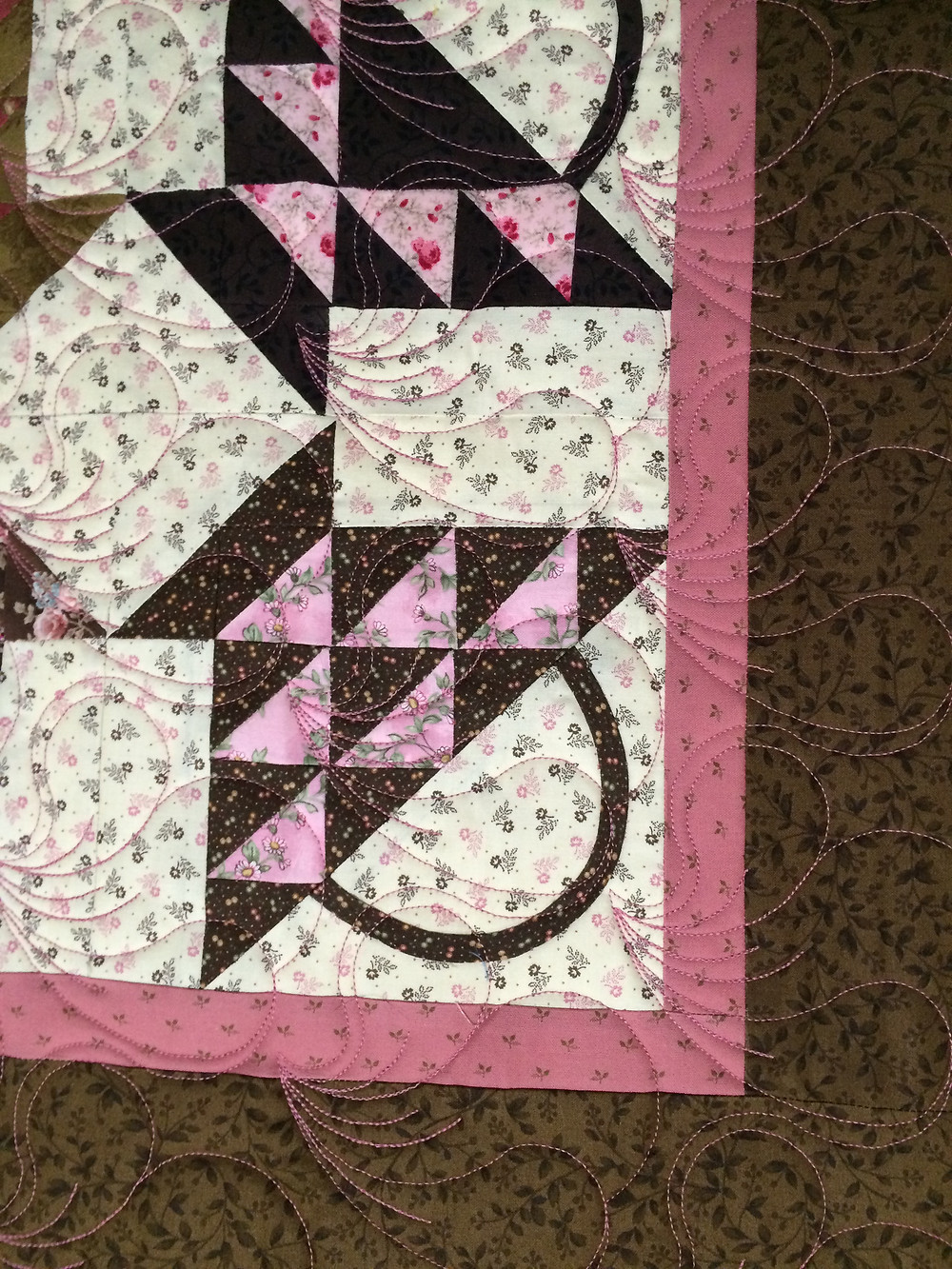 Feathers Quilting Pattern on Baskets Quilt by Trish Wells