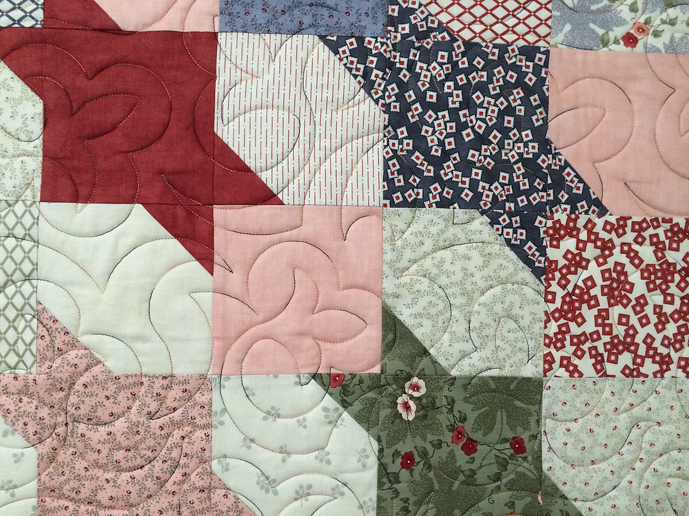 Leaves Quilting Pattern on Squares and Triangles Quilt by Debbie Seitz