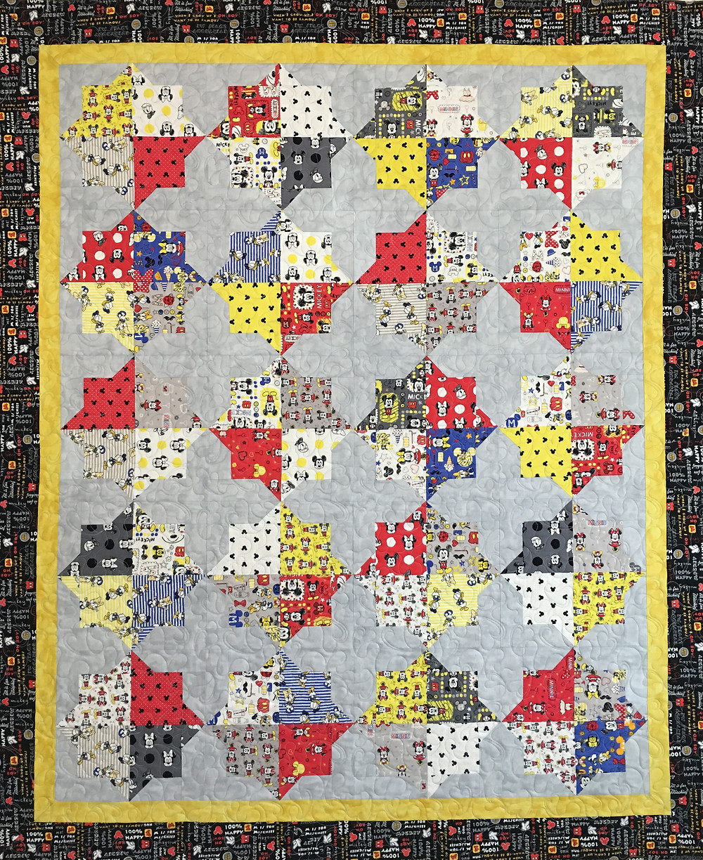 Mickey Mouse prints in Double Square Star Quilt by Cindy Lovelace