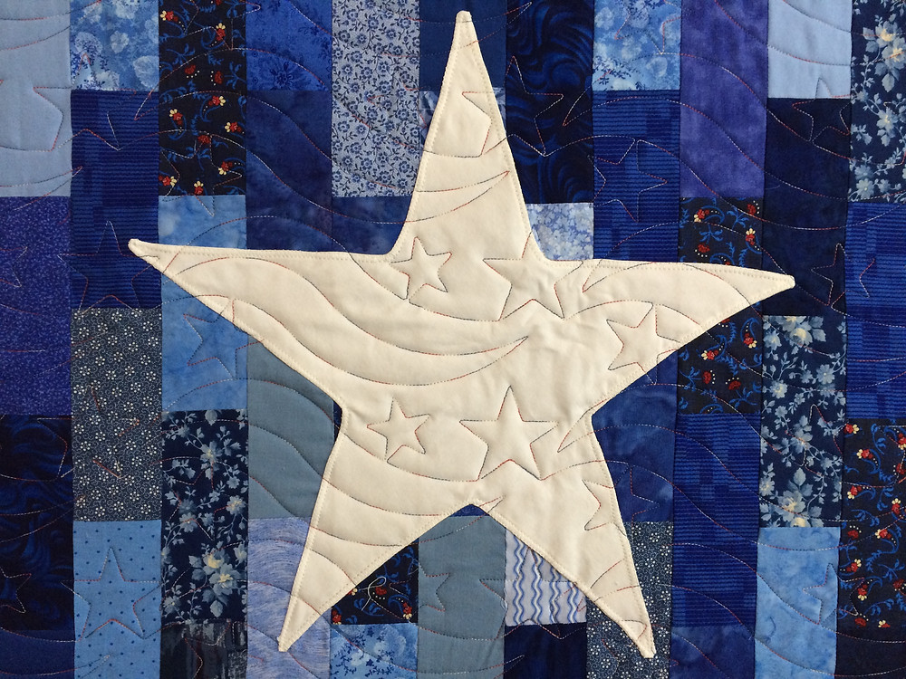 closeup of Texas Flag quilt with focus on lone star