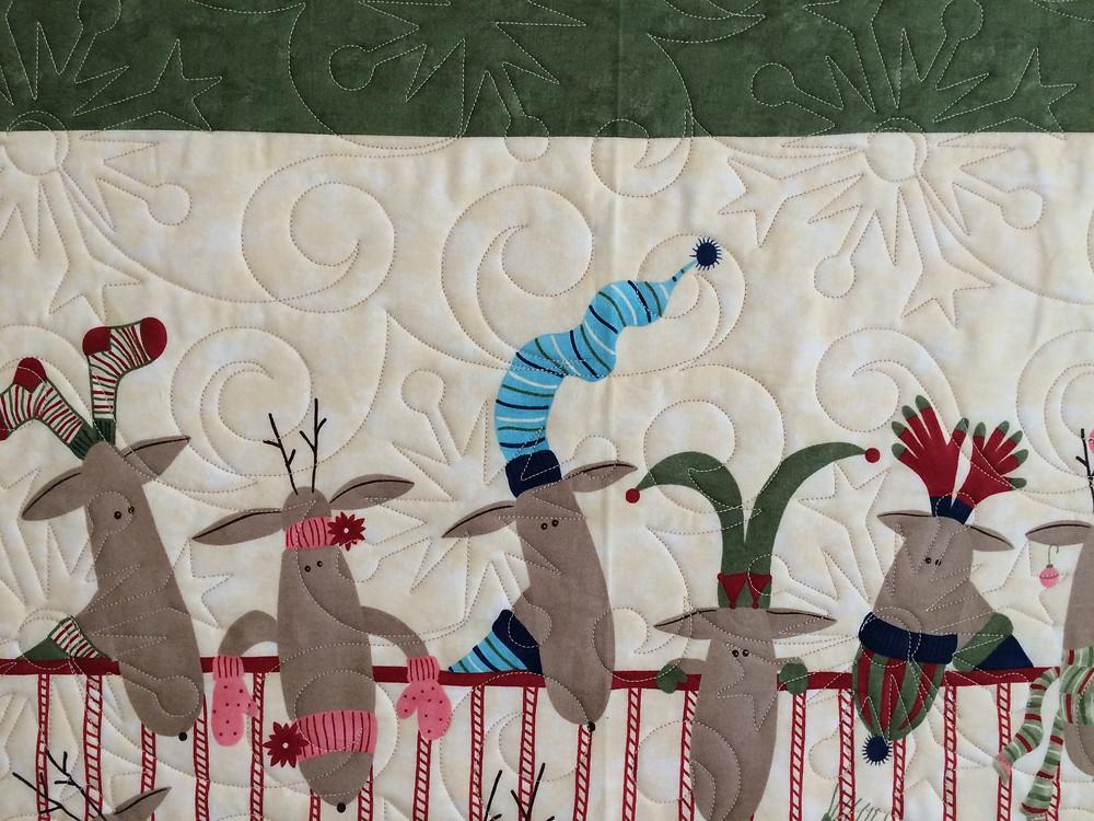 closeup of Nancy Thornton's Reindeer at play quilt