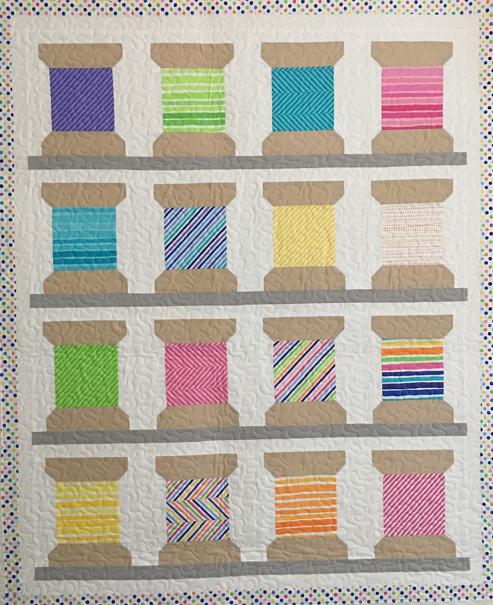 Spools of Thread quilt by Delfina Guerra